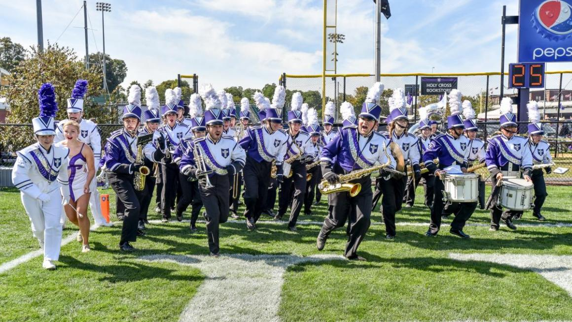 marching band students running