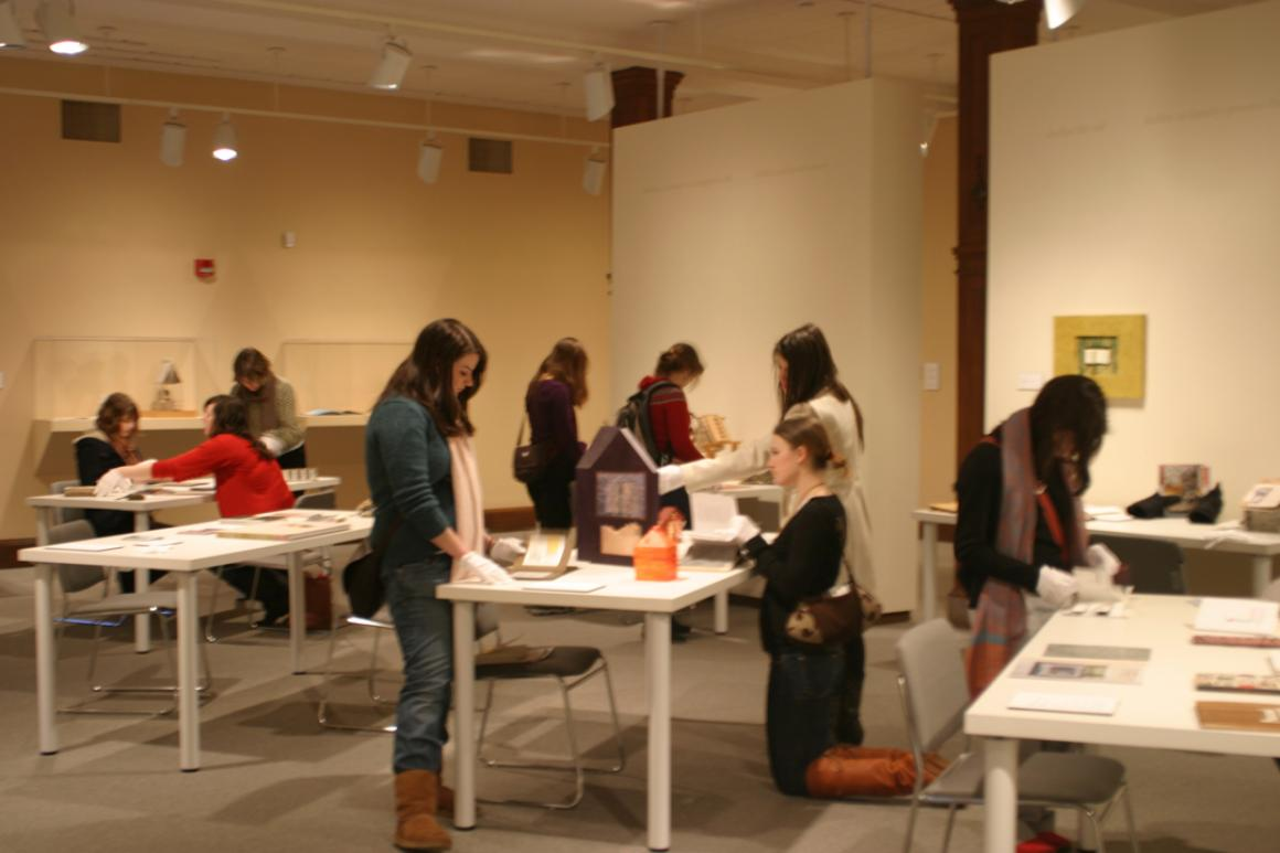 Students viewing Shelter artists' books