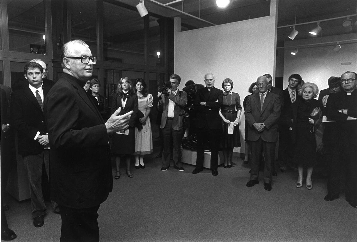 Rev. John E. Brooks, S.J., president of the College, speaks at the opening of the Iris & B. Gerald Cantor Art Gallery