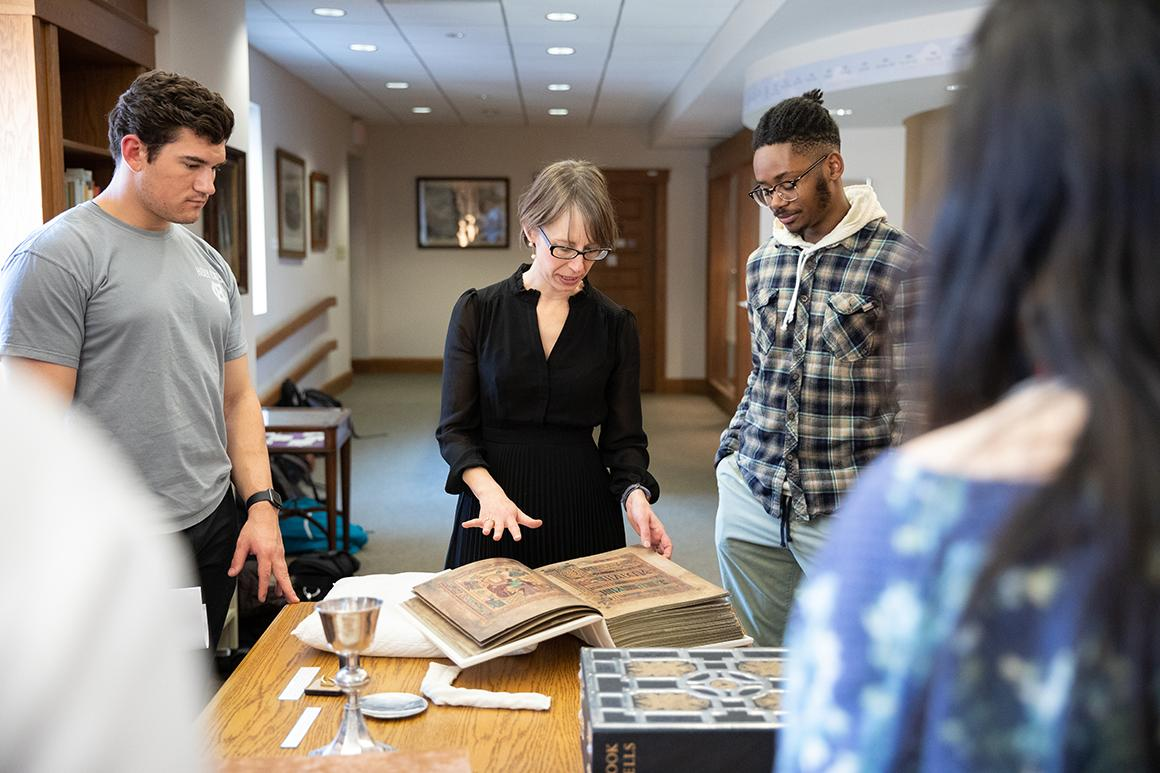 Senior lecturer Amanda Luyster conducts a course in the Archives and Special Collections area of Dinand Library at Holy Cross.