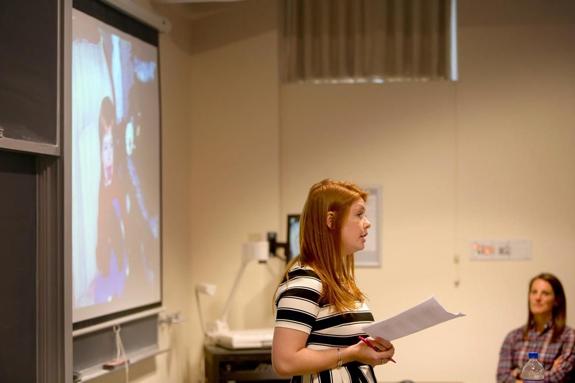 Student in front of a screen in a classroom