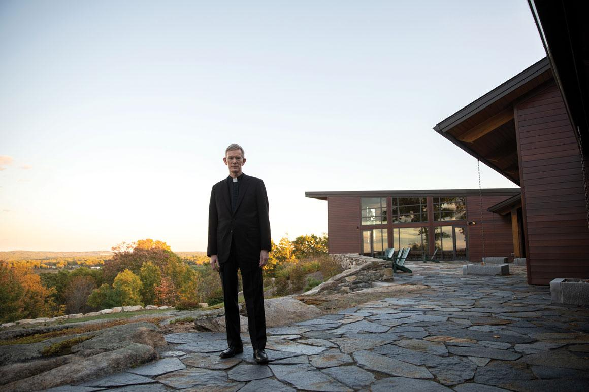 Fr. Boroughs, president of Holy Cross, standing in front of the Joyce Contemplative Center in West Boylston, Massachusetts.