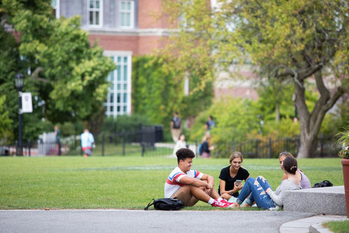 students sitting and conversing on hogan courtyard