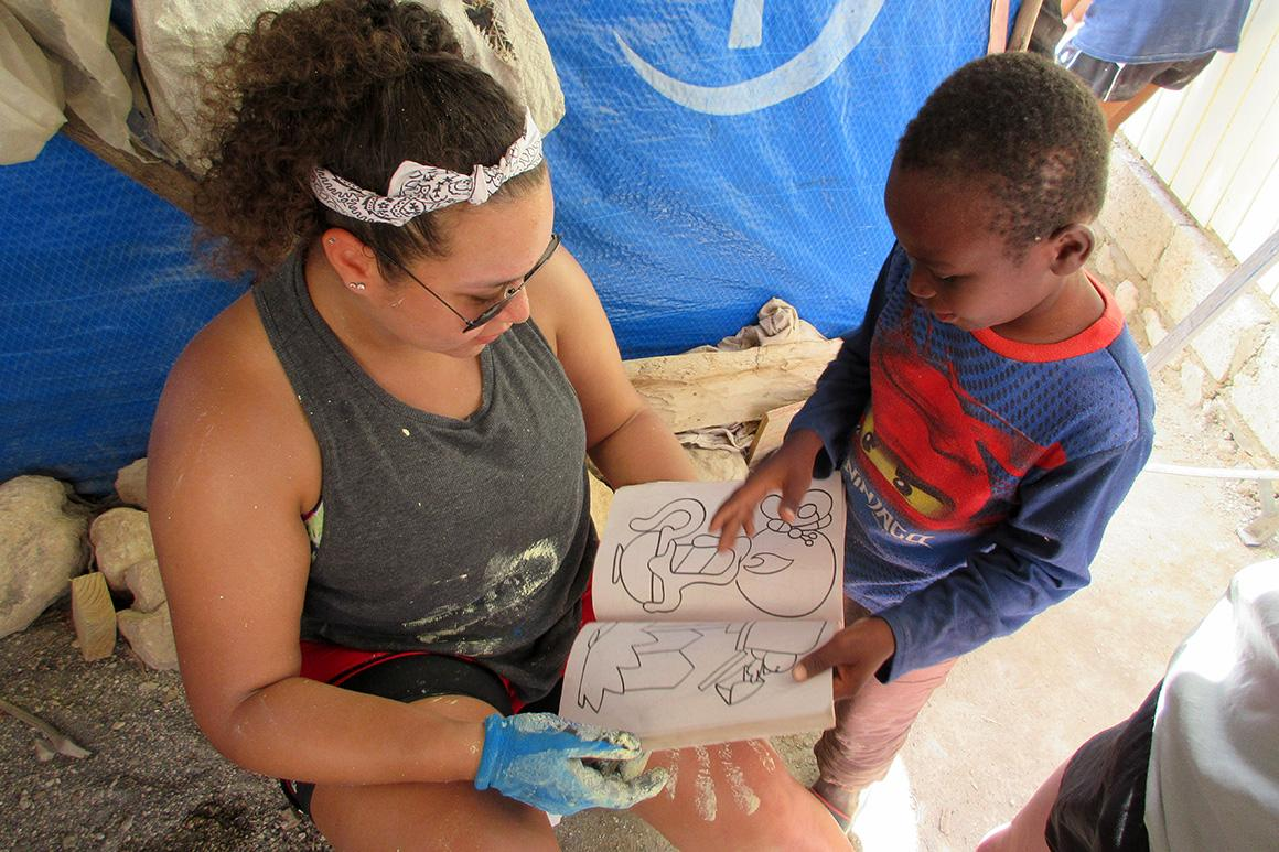 A Holy Cross student interacts with a student on an immersion program.
