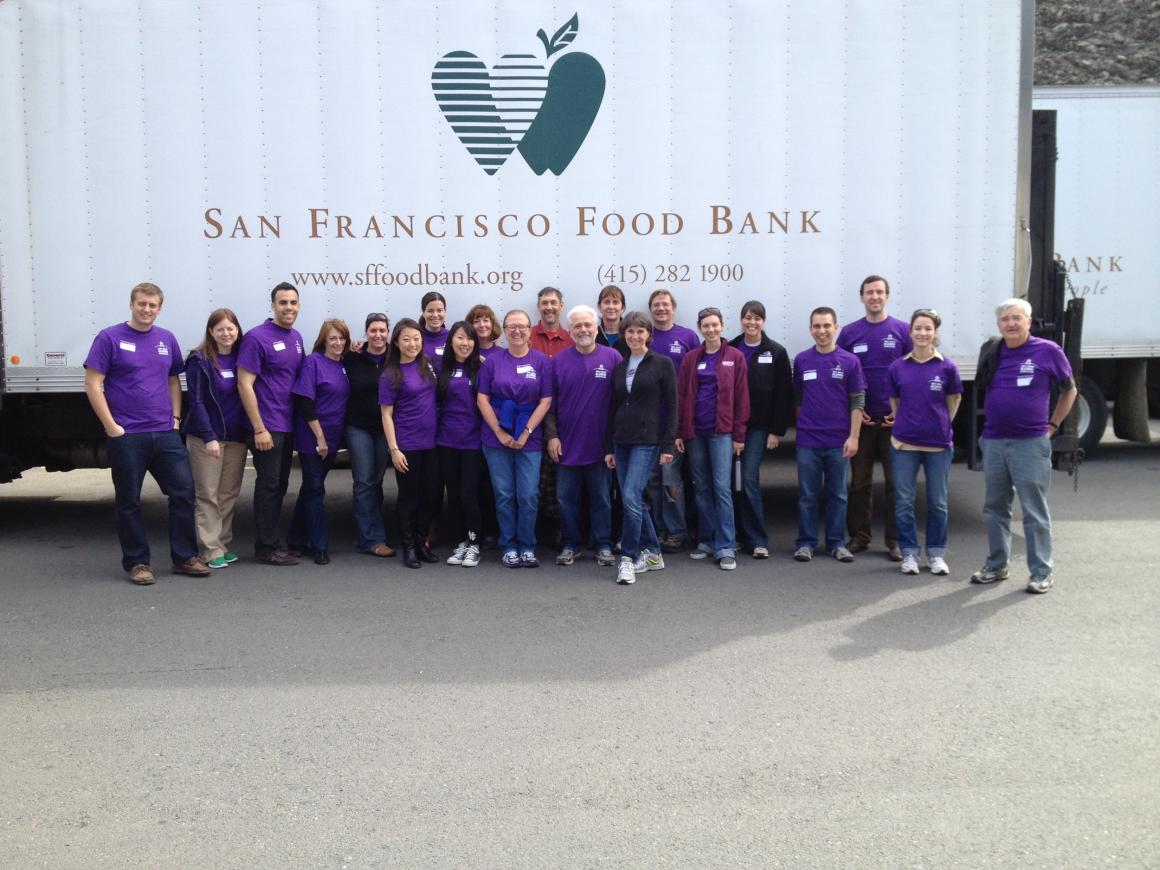 Group of people in purple t-shirts in front of San Francisco Food Bank truck