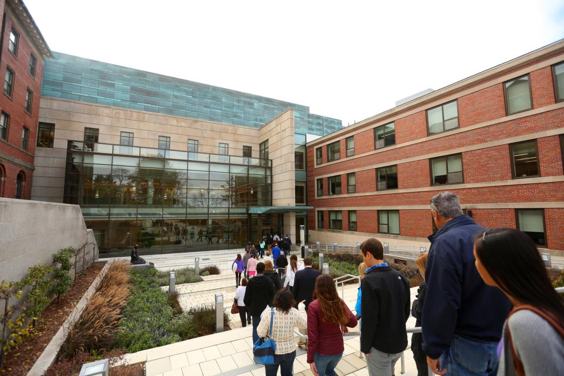 students and parents on an admissions tour walking down the stairs in front of the integrated science center
