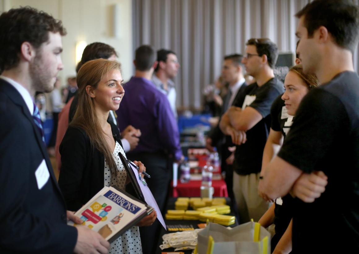 Students, alumni and employers conversing at a career fair