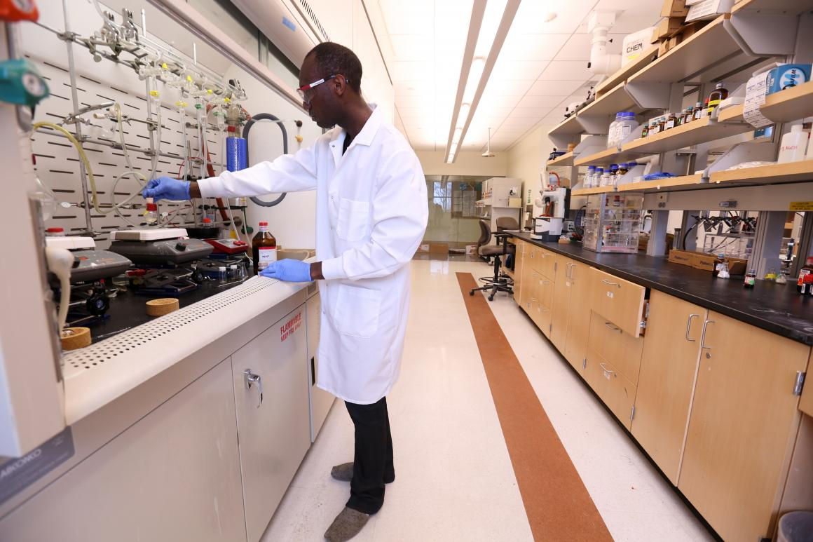 Faculty member in a lab