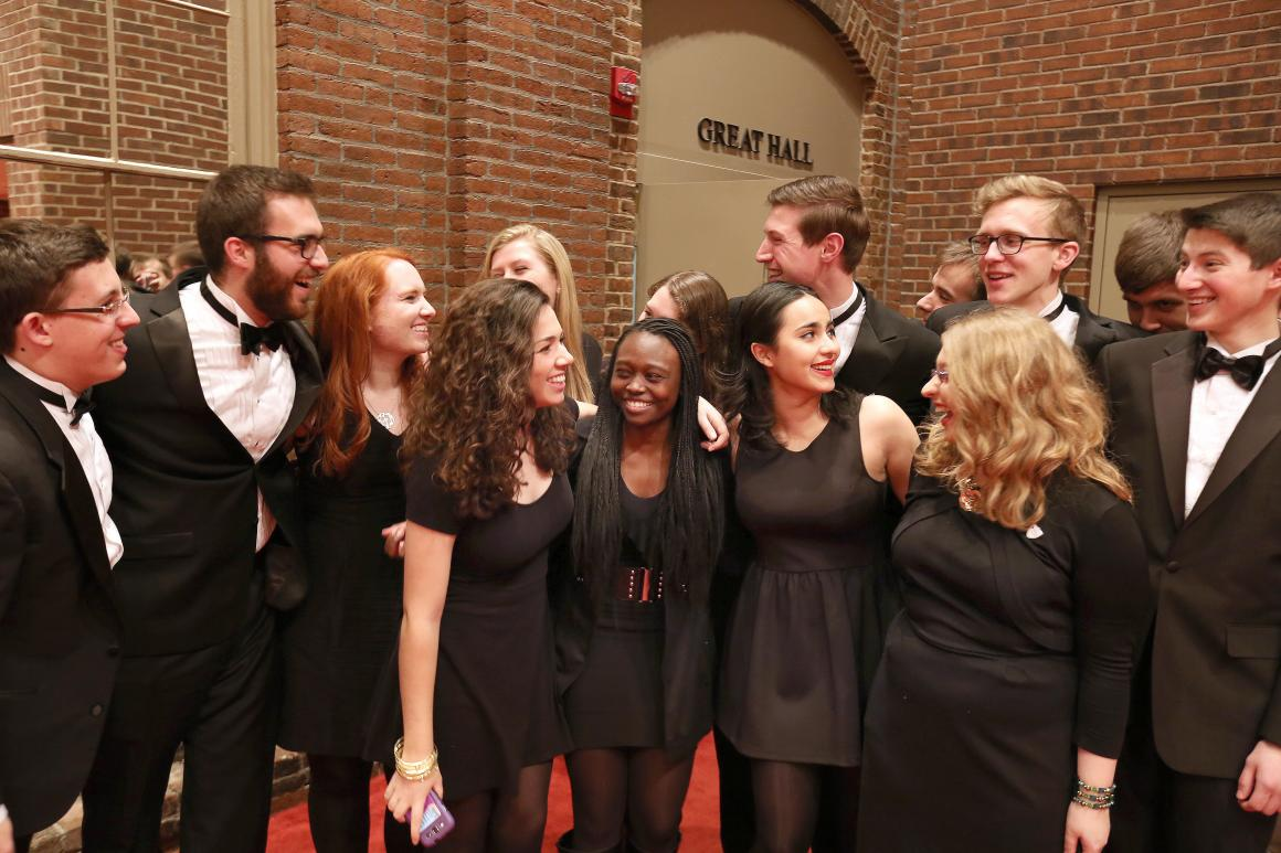 photo of 15 chamber singers students wearing black