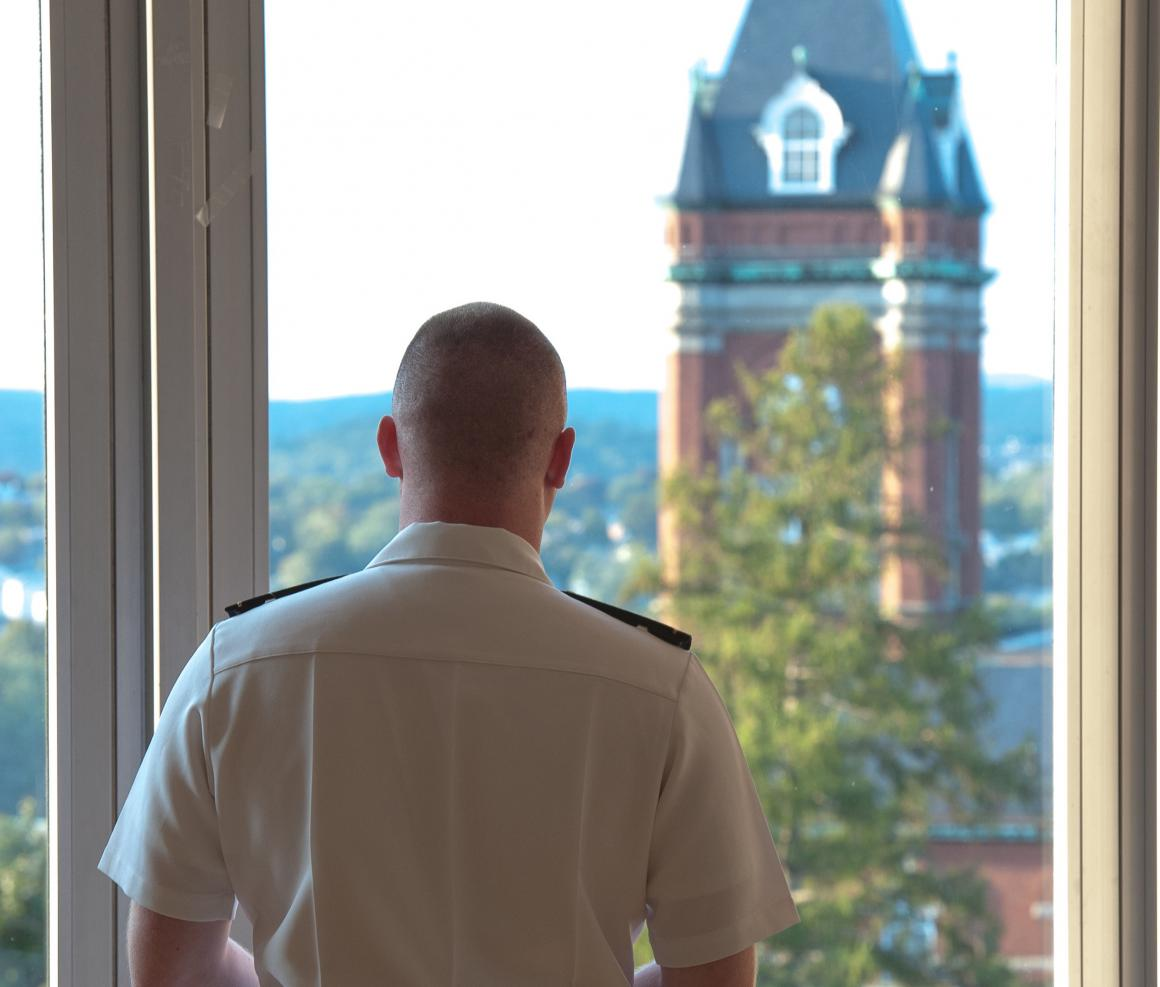 Back of person in uniform looking out of window