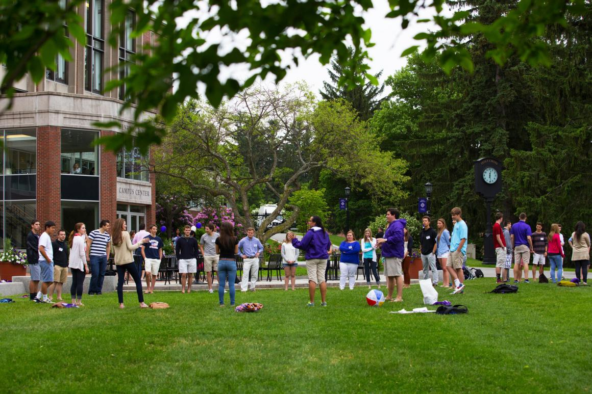 students on the Hogan Courtyard as part of orientation programming