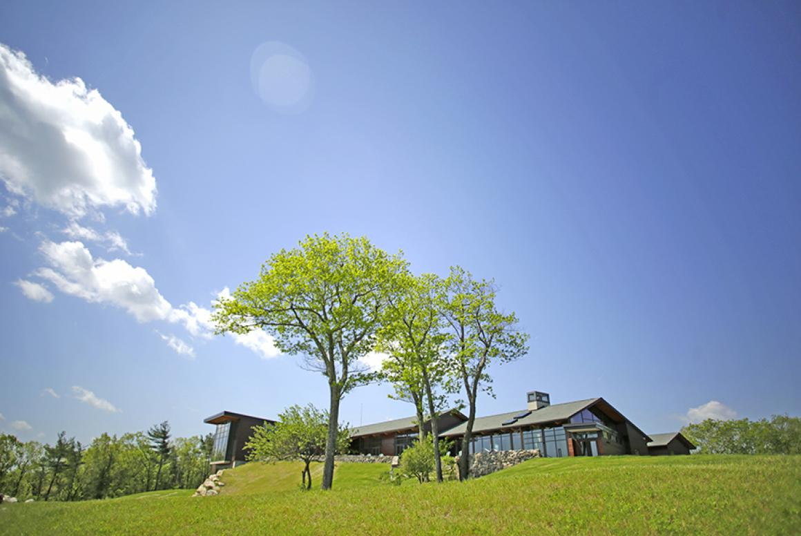 Joyce Contemplative Center with trees in the forefront
