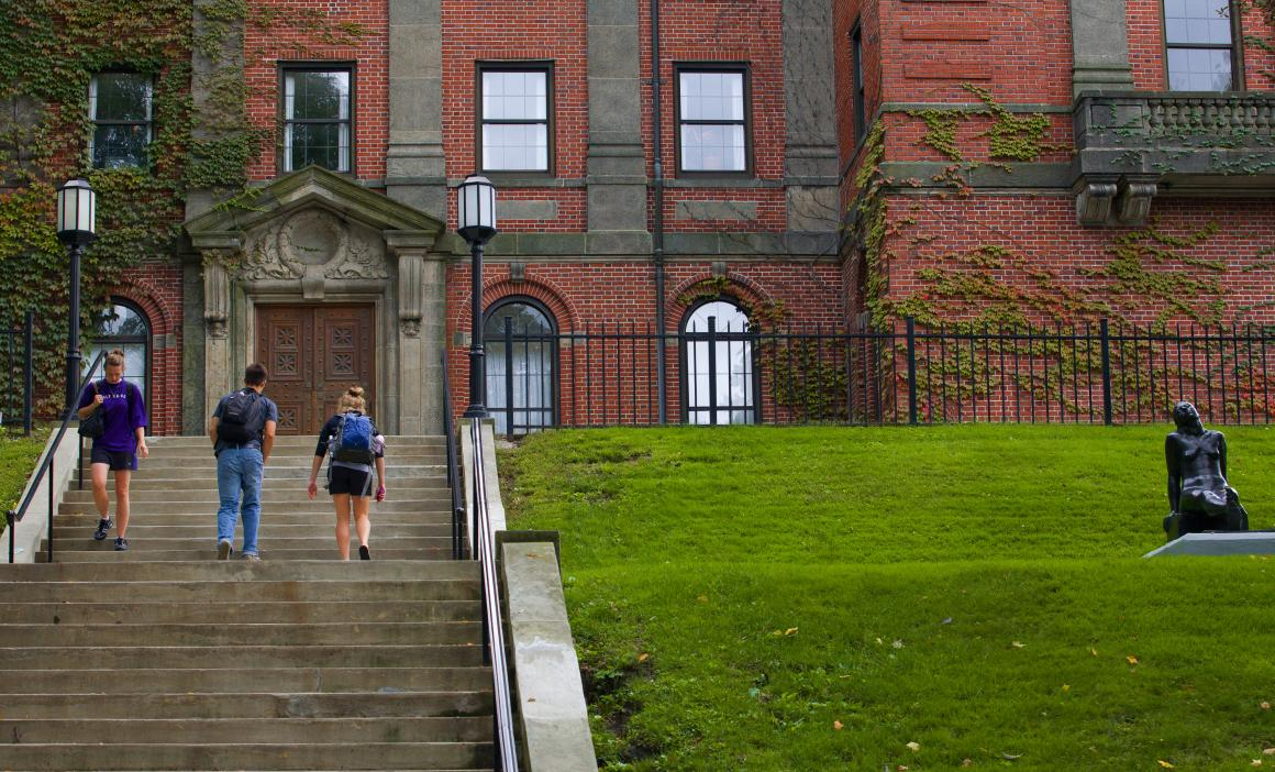 Students are walking up the stairs to the Library