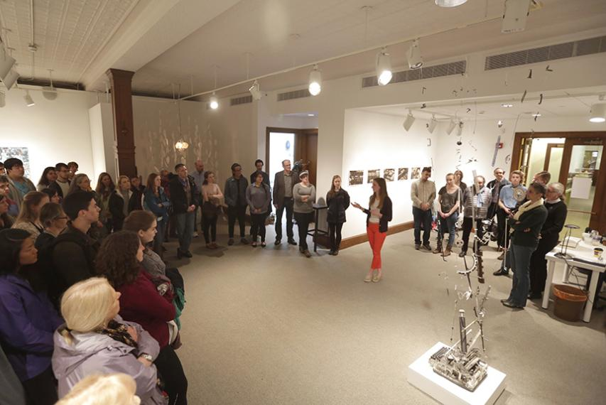 """Senior studio art major Mary Welsh '17 speaks to a crowded Cantor Art Gallery about her sculpture """"Eruption."""""""