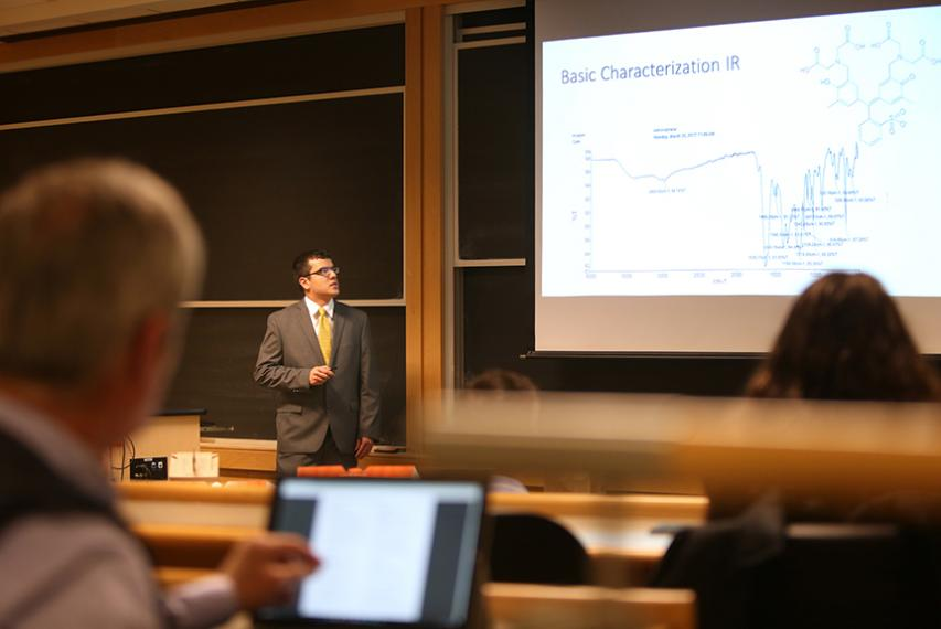 """Andrew Millonig '17, a chemistry major, delivers his oral presentation titled """"Novel Salicylimine conjugates and their attachment to rhenium,"""" in Smith Labs."""