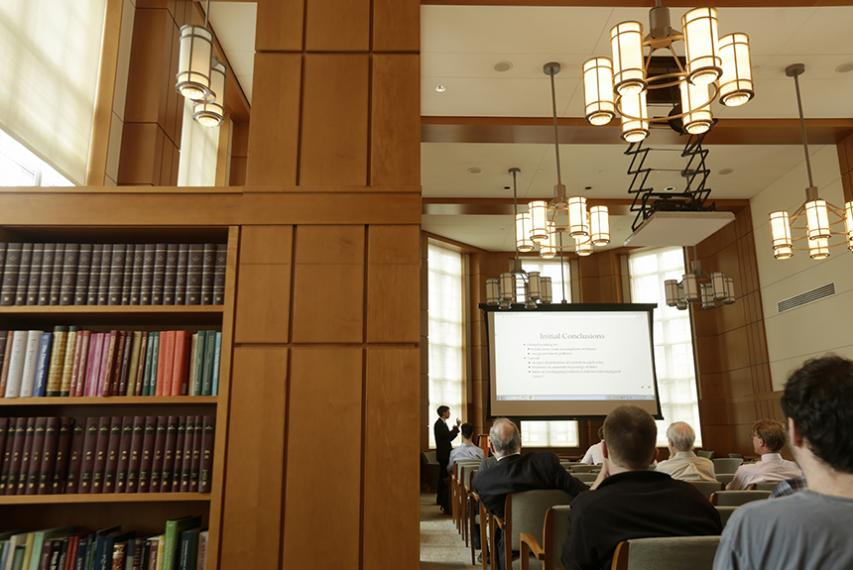 """Charles Schufreider '17, a classics major in the College Honors Program, presents his honors thesis, """"On the Format of the Scholia to the Iliad in the Venetus A Manuscript,"""" in Rehm Library."""