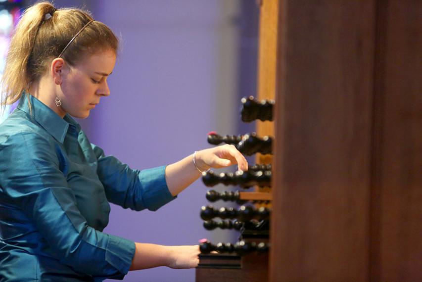 """Organ scholar Lorraine Mihaliak '19, a music major, presents and performs """"There and Bach Again"""" in St. Joseph Memorial Chapel."""