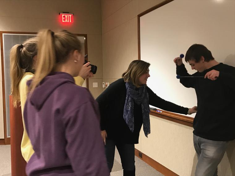 """Lauren Wilson, Margaret Goddard, and Mickenzie set up a photo shoot of student performers who participated in """"A Gun Show"""""""