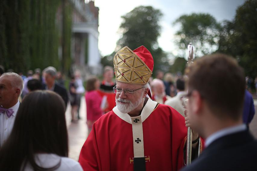 Archbishop of Boston Seán Cardinal O'Malley, O.F.M. Cap. stands with College President Rev. Philip L. Boroughs, S.J. during Mass. Photo by Tom Rettig