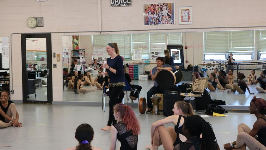 Working with Silkroad artists, Carley Stebbins '20 leads a movement-based exploration of geometry with Burncoat High dance students