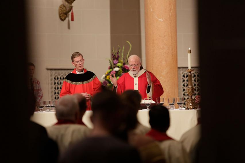Archbishop of Boston Seán Cardinal O'Malley, O.F.M. Cap. talks to members of the community. Photo by Tom Rettig