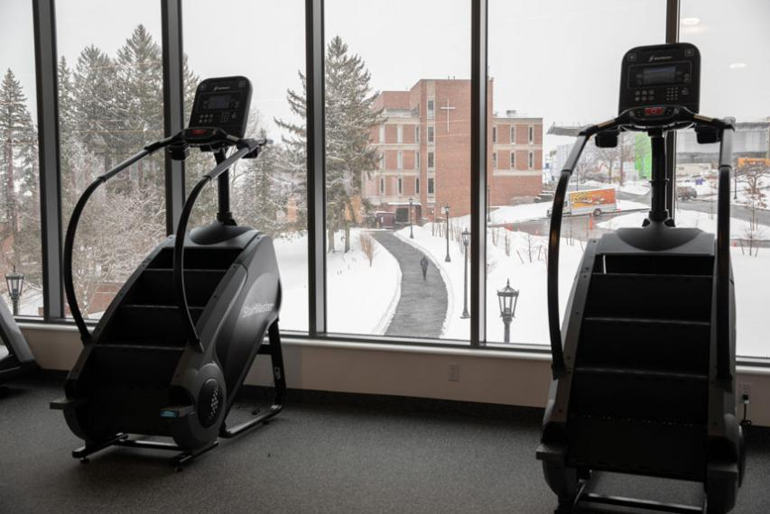 Exercise equipment in The Jo with views of upper campus through the windows