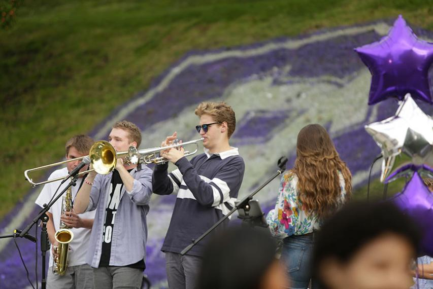 SCONE plays in front of a large Holy Cross 175th logo painted onto the grass. Photo by Tom Rettig