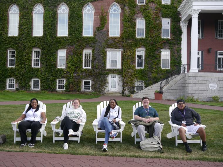 students sitting in front of fenwick hall