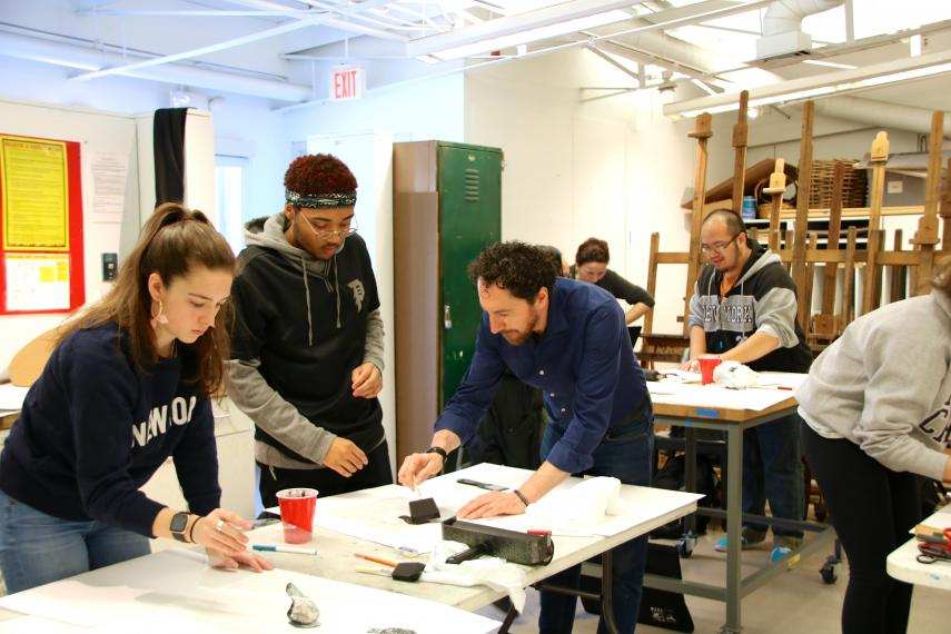 Kevork Mourad works with students in Intermediate Drawing