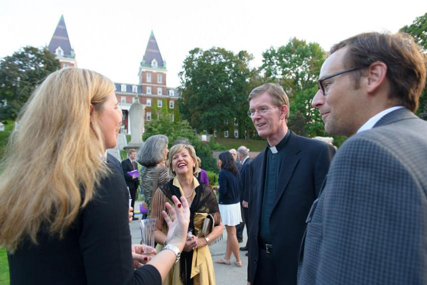 Fr. Boroughs interacting with guests at his inauguration festivities on Kimball Quad.