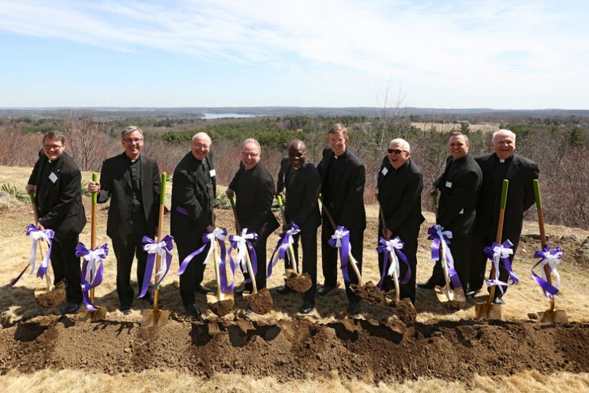 Fr. Boroughs, president of Holy Cross, and other Jesuits shoveling dirt at the groundbreaking of the Joyce Contemplative Center in West Boylston, Massachusetts