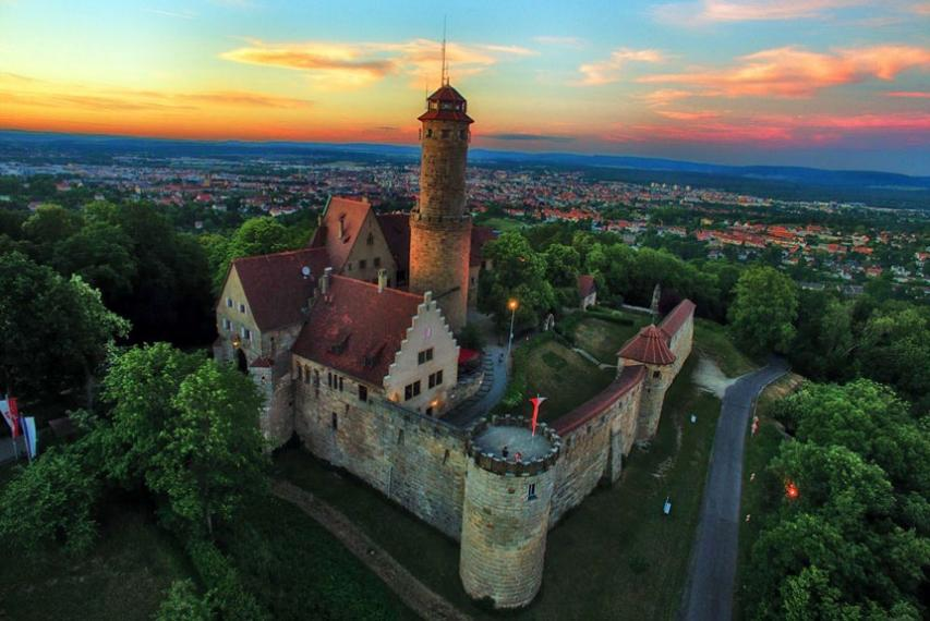 Aerial view of the Altenburg, a castle that sits on top of the tallest of the seven hills of Bamberg, Germany.