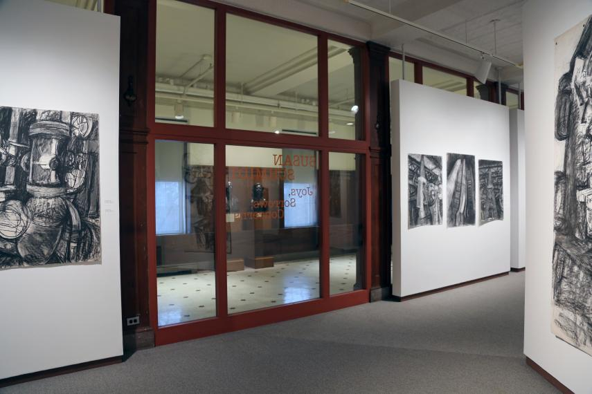 Center of gallery view towards glass wall