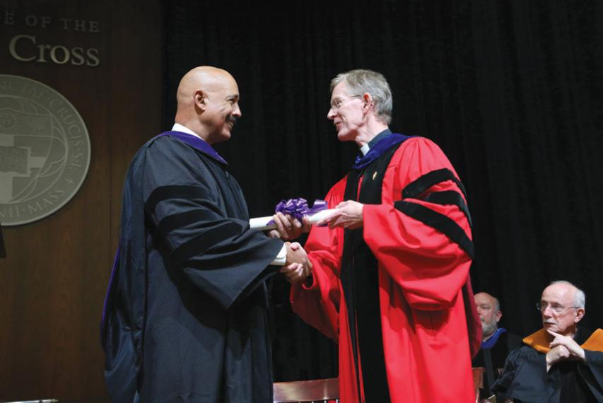 """Fr. Boroughs handing an honorary degree to Theodore V. """"Ted"""" Wells Jr. '72 in the Hogan Ballroom."""